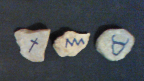 From right to left: Ox head - strong, power, leader, mighty, champion; Water - chaos, powerful, blood; Two crossed sticks - mark, sign, character, signature, note.